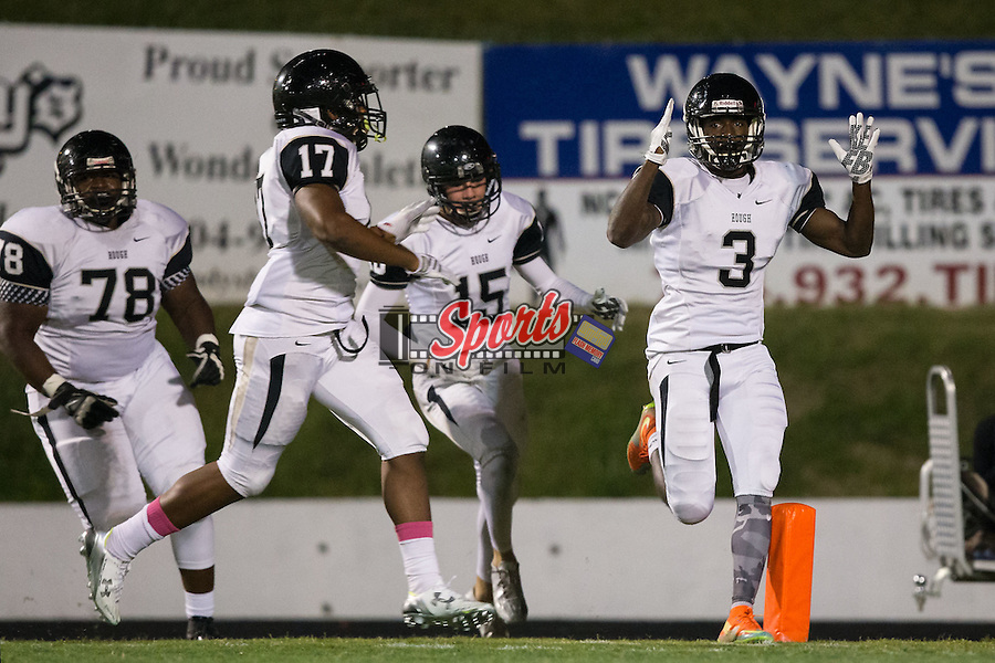 Marquill Osborne (3) of the Hough Huskies celebrates after returning an interception for a touchdown during first quarter action against the A.L. Brown Wonders at A.L. Brown High School on October 16, 2015 in Kannapolis, North Carolina.  The Huskies defeated the Wonders 21-7.  (Brian Westerholt/Sports On Film)