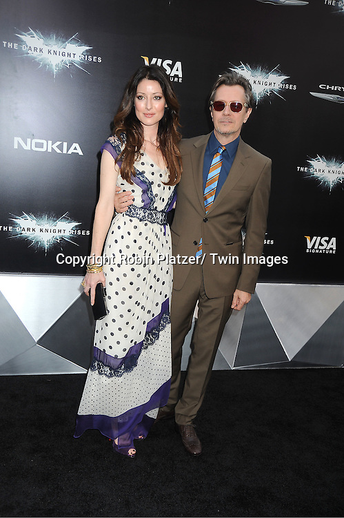 """Gary Oldman and wife Alexandra Edenborough attends the world premiere of """"The Dark Knight Rises"""" on .July 16, 2012 at The AMC Lincoln Square Imax Theatre in New York City. The movie stars Christian Bale, Gary Oldman, Anne Hathaway, Tom Hardy, Marion Cotillard, Joseph Gordon-Levitt and Morgan Freeman."""