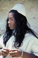 Portrait of a native Arhuaco indian man in the village of San Sebastian, located in the Sierra Nevada de Santa Marta mountains of coastal Colombia. He wears traditional woolen clothing.