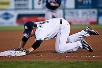 August 7,2010 Travis Metcalf (5) in action during the MiLB game between the New Orleans Zephyrs and the Colorado Springs Sky Sox at Security Service Field in Colorado Springs Colorado.