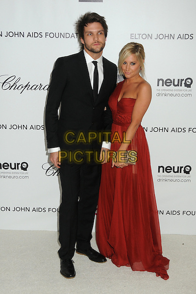 Martin Johnson & Ashley Tisdale.20th Annual Elton John Academy Awards Viewing Party held at West Hollywood Park, West Hollywood, California, USA..February 26th, 2012.oscars full length dress red one shoulder   silver clutch bag black suit couple.CAP/ADM/BP.©Byron Purvis/AdMedia/Capital Pictures.