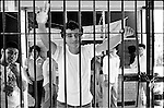 Jesus Vicente, a leader of the Coalicion Obrera campesina Estudiantil del Istmo (COCEI) stands up behind bars at the state prison of Tehuantepec, Oaxaca, circa February, 1984. Jesus Vicente was kidnapped by state authorities and disappeared on late December, 1983 after being accused for murder in Juchitan when he was at Mexico City at that time. Vicente was released after holding a hunger strike for more than five weeks.  © Photo by Heriberto Rodriguez