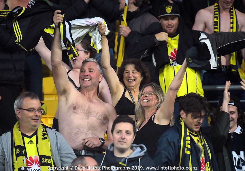 Phoenix fans celebrate during the A-League football match between Wellington Phoenix and Melbourne City FC at Westpac Stadium in Wellington, New Zealand on Sunday, 21 April 2019. Photo: Dave Lintott / lintottphoto.co.nz
