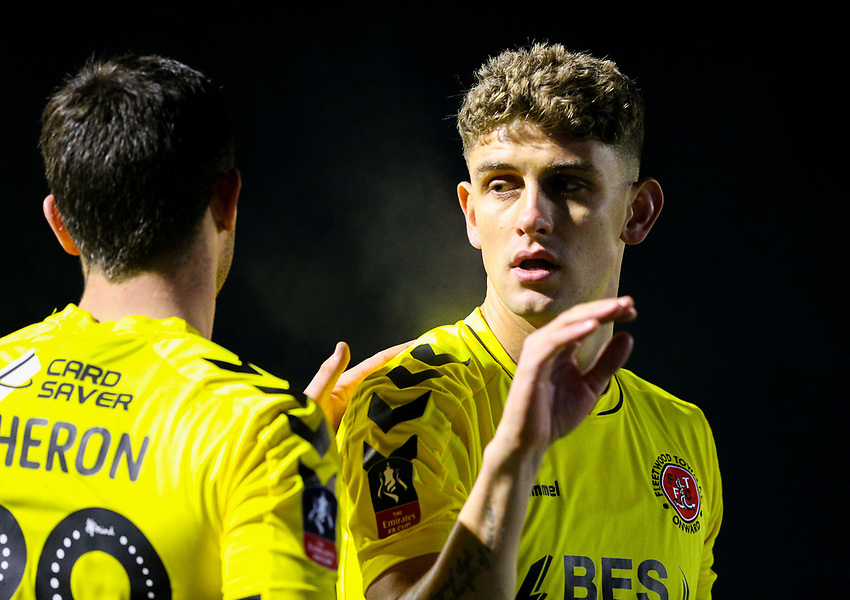 Fleetwood Town's Harrison Biggins celebrates with Nathon Sheron after the game<br /> <br /> Photographer Alex Dodd/CameraSport<br /> <br /> The Emirates FA Cup Second Round - Guiseley v Fleetwood Town - Monday 3rd December 2018 - Nethermoor Park - Guiseley<br />  <br /> World Copyright © 2018 CameraSport. All rights reserved. 43 Linden Ave. Countesthorpe. Leicester. England. LE8 5PG - Tel: +44 (0) 116 277 4147 - admin@camerasport.com - www.camerasport.com