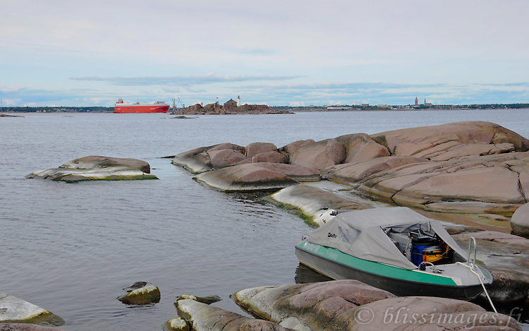 With my maneuverable,40hp, little boat tethered to a skerry, I prepare to photograph Gustavsvärn Lighthouse which marks the shipping channel at Hanko, Finland
