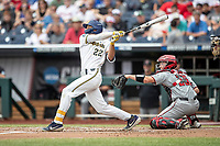 Michigan Wolverines outfielder Jordan Brewer (22) follows through on his swing during Game 11 of the NCAA College World Series against the Texas Tech Red Raiders on June 21, 2019 at TD Ameritrade Park in Omaha, Nebraska. Michigan defeated Texas Tech 15-3 and is headed to the CWS Finals. (Andrew Woolley/Four Seam Images)