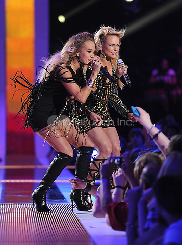 NASHVILLE, TN - JUNE 4: Carrie Underwood and Miranda Lambert perform on the 2014 CMT Music Awards at the Bridgestone Arena on June 4, 2014 in Nashville, Tennessee.MPIMicelotta/MediaPunch