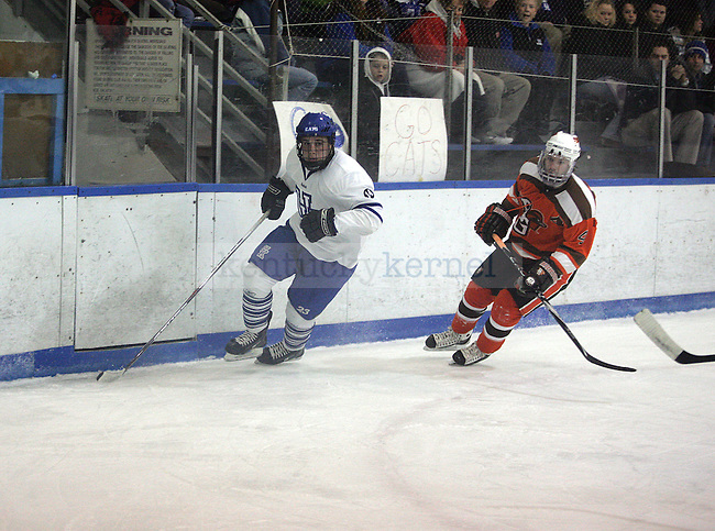 UK Hockey player Greg Monson chases the puck drives the puck in the game  against Bowling Green State University at the Lexington Ice Center on November 7, 2010. Photo by Ryan Buckler | Staff