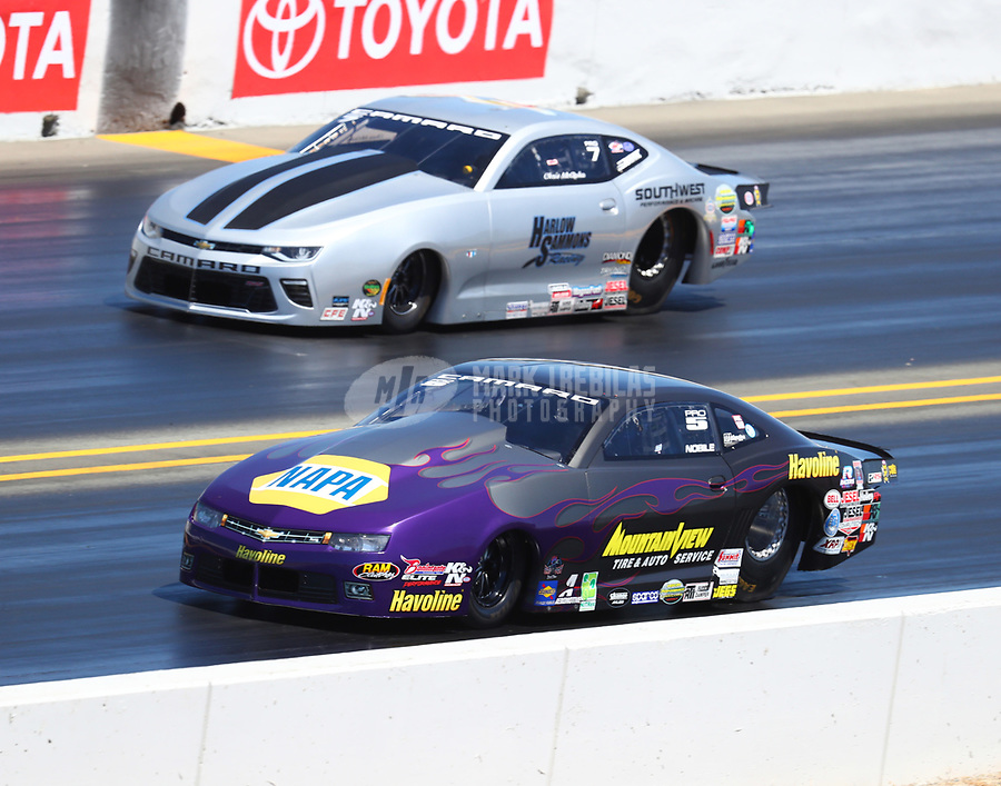 Jul 29, 2017; Sonoma, CA, USA; NHRA pro stock driver Vincent Nobile (near) races alongside Chris McGaha during qualifying for the Sonoma Nationals at Sonoma Raceway. Mandatory Credit: Mark J. Rebilas-USA TODAY Sports