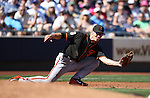 SF Giants' Kelby Tomlinson makes a stabbing catch in a spring training game against the Seattle Mariners in Peoria, Ariz., on Wednesday, March 16, 2016. <br />