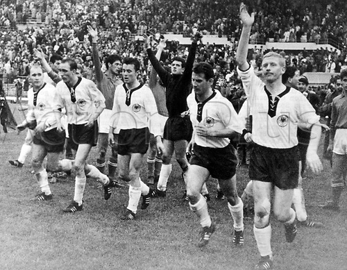 The exhausted but satisfied German players (L-R) Herbert Erhardt, Willi Schulz, Hans Nowak, Hans Schaefer and Karl-Heinz Schnellinger cheer and celebrate as they run a lap of honour across the pitch and greet their fans  after their goaless draw in the 1962 World Cup group game.  Italy against Germany at the National Stadium in Santiago de Chile, Chile on 31 May 1962.