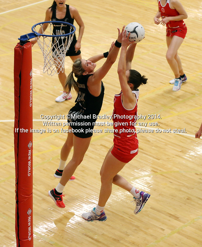 28.10.2014 Silver Ferns Leana de Bruin and England's Rachel Dunn in action during the Silver Ferns V England netball match played at the Rotorua Events Centre in Rotorua. Mandatory Photo Credit ©Michael Bradley.