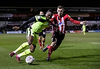 Bolton Wanderers' Joe Dodoo competing with Lincoln City's Harry Toffolo (right) <br /> <br /> Photographer Andrew Kearns/CameraSport<br /> <br /> The EFL Sky Bet League One - Lincoln City v Bolton Wanderers - Tuesday 14th January 2020  - LNER Stadium - Lincoln<br /> <br /> World Copyright © 2020 CameraSport. All rights reserved. 43 Linden Ave. Countesthorpe. Leicester. England. LE8 5PG - Tel: +44 (0) 116 277 4147 - admin@camerasport.com - www.camerasport.com