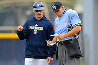 4 March 2012:  FIU Assistant Coach Scott Pittinger speaks with an umpire in between innings as the FIU Golden Panthers defeated the Brown University Bears, 8-3, at University Park Stadium in Miami, Florida.