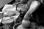 Clay Artisan shaping a round pot at his shop in St. Georges Bermuda.