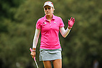 Lexi Thompson waves to the fans on the 1st green at the LPGA Championship 2014 Sponsored By Wegmans at Monroe Golf Club in Pittsford, New York on August 16, 2014