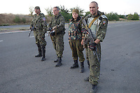 Russian fighters from the Donetsk People's Republic in Novotroiske on the highway to Mariupol. September, 2014.