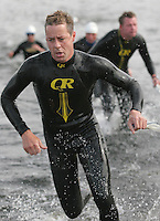 06 AUG 2005 - HOLME PIERREPONT, UK - Competitors exit the water during the British Triathlon Club Relay Championships. (PHOTO (C) NIGEL FARROW)