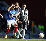 Ian Black held back by the Elgin midfield