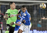 BOGOTA - COLOMBIA -27 -11-2016: Andres Escobar (Der) jugador de Millonarios disputa el balón con Gilberto Alcatraz Garcia (Izq) jugador de Atlético Nacional durante partido de ida por los cuartos de final de la Liga Aguila II 2016 jugado en el estadio Nemesio Camacho El Campin de la ciudad de Bogota./ Andres Escobar (R) player of Millonarios fights for the ball with Gilberto Alcatraz Garcia (L) player of Atletico Nacional during first leg match for the final quarters of the Liga Aguila II 2016 played at the Nemesio Camacho El Campin Stadium in Bogota city. Photo: VizzorImage / Gabriel Aponte / Staff.