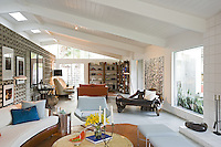 Mid-century modern living room is seen with modern furnisture