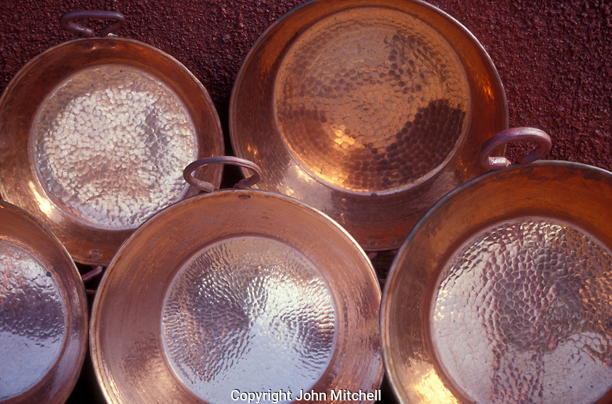 Copper pans for sale in the village of Santa Clara del Cobre near Lake Patzcuaro, Michoacan, Mexico