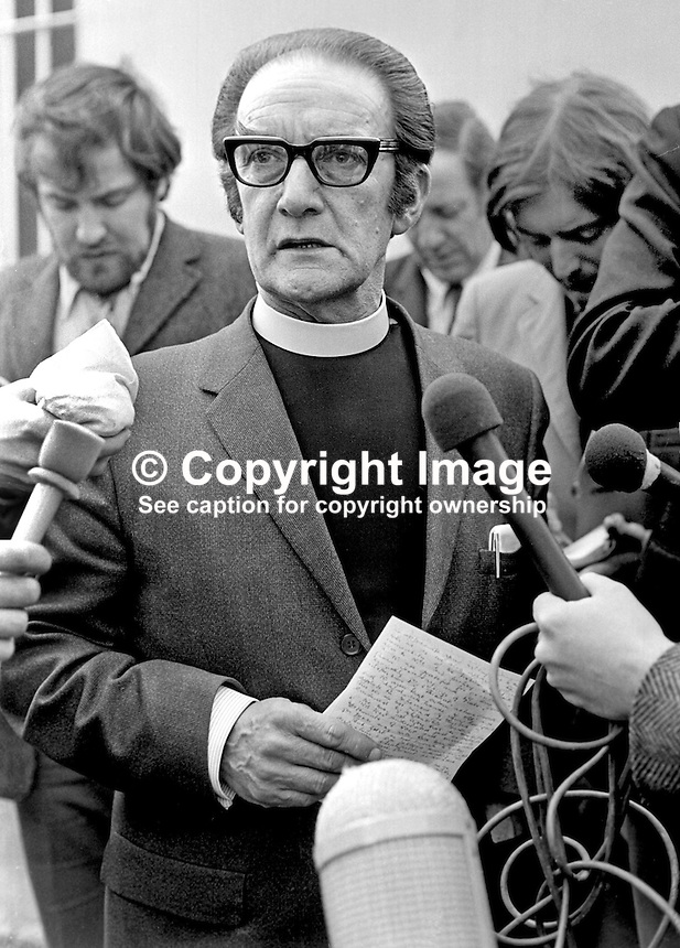 Rev Donald Gilllies, Agnes Street Presbyterian Church, located in Protestant West Belfast, is questioned by newspaper and television journalists after a meeting he had with the N Ireland Secretary of State, William Whitelaw at Stormont Castle in June 1972. 197206000400DG.<br /> <br /> Copyright Image from Victor Patterson, 54 Dorchester Park, Belfast, UK, BT9 6RJ<br /> <br /> t1: +44 28 9066 1296 (from Rep of Ireland 048 9066 1296)<br /> t2: +44 28 9002 2446 (from Rep of Ireland 048 9002 2446)<br /> m: +44 7802 353836<br /> <br /> e1: victorpatterson@me.com<br /> e2: victorpatterson@gmail.com<br /> <br /> The use of my copyright images is subject to my Terms &amp; Conditions.<br /> <br /> It is IMPORTANT that you familiarise yourself with them. They are available on my website at www.victorpatterson.com.<br /> <br /> None of my copyright images may be used on a website unless they are visibly watermarked, i.e. &copy; Victor Patterson within the body of the visible image. Metadata denoting my copyright must NOT be deleted. <br /> <br /> Web use is extra at currently recommended NUJ rates.