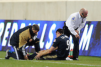 Sebastien Le Toux (9) of the Philadelphia Union grabs his knee as he is examined by a trainer after being injured during the second half. The New York Red Bulls defeated the Philadelphia Union 2-1 during a US Open Cup qualifier at Red Bull Arena in Harrison, NJ, on April 27, 2010.