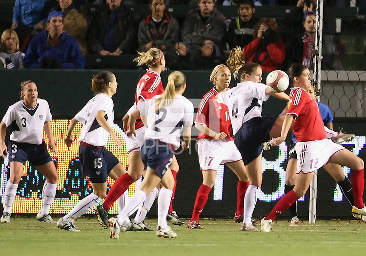 Christine Sinclair and Catherine Whitehill juggle the ball in front of the USA goal. USA captured the 2006 Gold Cup at Home Depot stadium in Carson, California on November 26 2006 thanks to a penalty kick call by the referee with only seconds remaining in the last period of overtime. With the penalty kick score USA beat Canada 2-1.