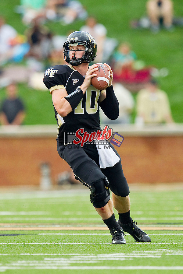 Tanner Price (10) of the Wake Forest Demon Deacons drops back to pass during first half action against the North Carolina Tar Heels at BB&T Field on September 8, 2012 in Winston-Salem, North Carolina.  The Demon Deacons defeated the Tar Heels 28-27.  (Brian Westerholt/Sports On Film)