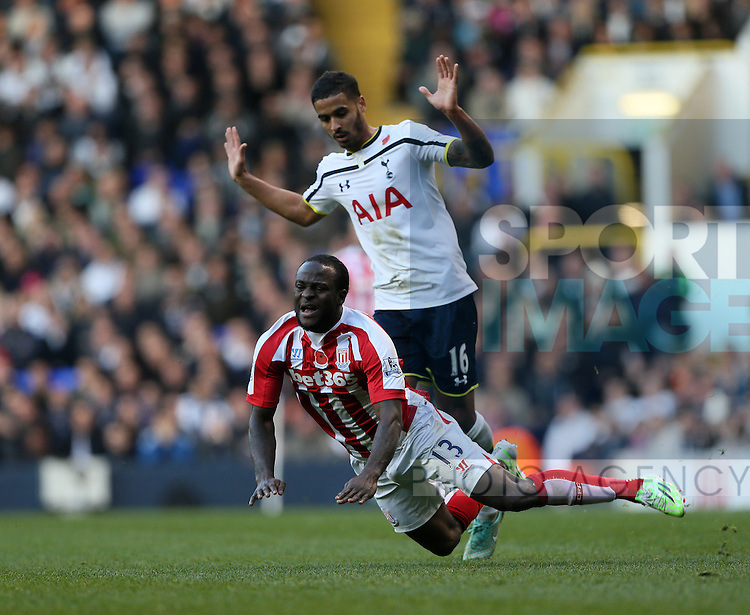 Tottenham's Kyle Naughton gets sent off for this tackle on Stoke's Victor Moses<br /> <br /> - Barclays Premier League - Tottenham Hotspur vs Stoke City- White Hart Lane - London - England - 9th November 2014  - Picture David Klein/Sportimage