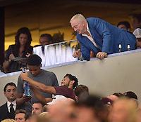 STAFF PHOTO BEN GOFF  @NWABenGoff -- 09/27/14  Jerry Jones, owner of the Dallas Cowboys, leans out of his box for a fan to take a selfie as Arkansas takes on Texas A&M in the Southwest Classic in AT&T Stadium in Arlington, Texas on Saturday September 27, 2014.
