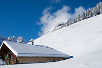 Mountain house on snow covered slopes of Gimmelwald in Swiss Alps