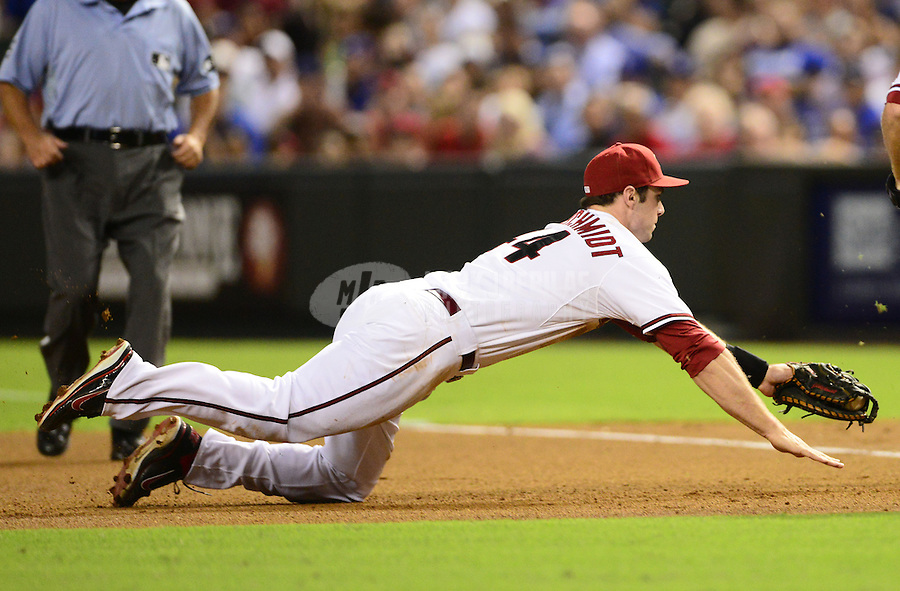 Sept. 11, 2012; Phoenix, AZ, USA: Arizona Diamondbacks first baseman Paul Goldschmidt dives into first base to force out Los Angeles Dodgers batter Shane Victorino (not pictured) in the fourth inning at Chase Field. Mandatory Credit: Mark J. Rebilas-