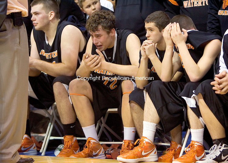 UNCASVILLE, CT. 17 March 2012-031712SV05-Watertown players, from left, #34 Thomas O'Brien, #22 Edward Hill, #4 George Gakidis, and #2 Christopher DosSantos react to a 71-57 loss to Waterford during the CIAC Class M Championship at Mohegan Sun Arena in Uncasville Saturday..Steven Valenti Republican-American