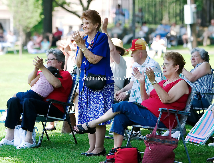 WATERBURY, CT- 08 JULY 2007- 070807JT03-<br /> From left, Candice Englehardt of Waterbury with her granddaughter Alisson Negrone, Olympia Pinto of Waterbury and Dora Wilcox of Northfield applaud the Waterbury Symphony Orchestra after a song during the orchestra's first free outdoor summer pops concerts at Library Park in Waterbury on Sunday.<br /> Josalee Thrift Republican-American
