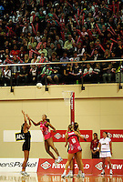 NZ's Maria Tutaia shoots for goal during the International  Netball Series match between the NZ Silver Ferns and World 7 at TSB Bank Arena, Wellington, New Zealand on Monday, 24 August 2009. Photo: Dave Lintott / lintottphoto.co.nz