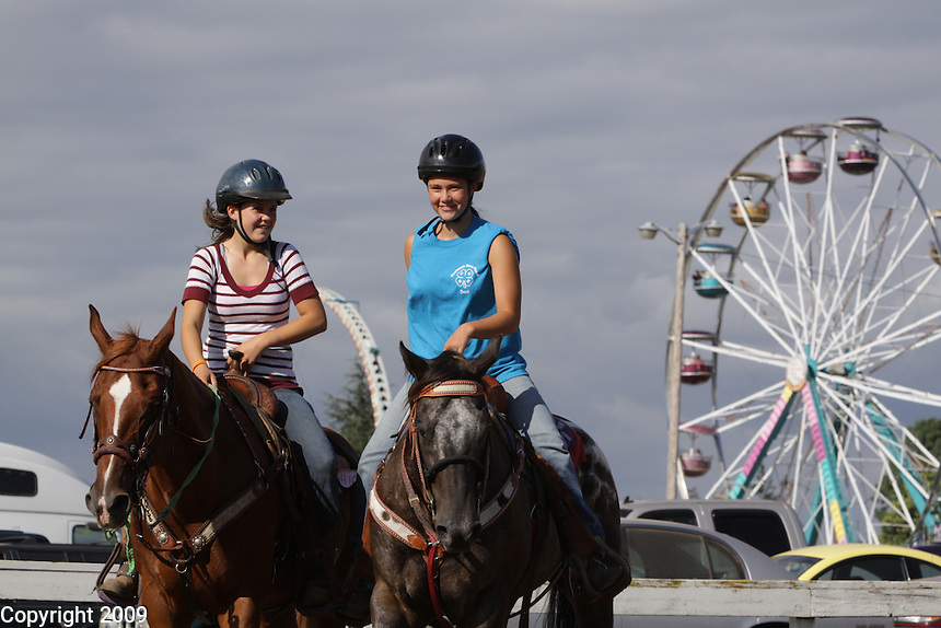Miranda Ackerson, 14, Stewart Mt. Gang, Van Sandnt, 4H, left, and Lacy Cannon, 13, Nooksack River Posse, right. NW Washington Fair. August 21, 2009 PHOTOS BY MERYL SCHENKER