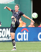 Abby Wambach #20 of the Washington Freedom slices a pass during a WPS match against ST. Louis Athletica on May 1 2010, at RFK Stadium, in Washington D.C. Freedom won 3-1.
