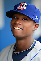 Durham Bulls shortstop Tim Beckham #22 in the dugout before a game against the Rochester Red Wings on May 17, 2013 at Frontier Field in Rochester, New York.  Rochester defeated Durham 11-6.  (Mike Janes/Four Seam Images)