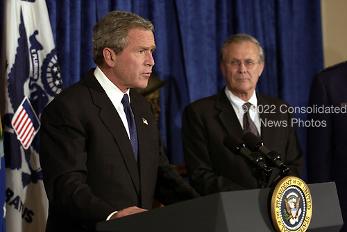 United States President George W. Bush makes a statement to the press in the Pentagon on May 10, 2004, as US Secretary of Defense Donald H. Rumsfeld looks on.  <br /> Mandatory Credit: Jerry Morrison / DoD via CNP