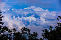 Peaks of the Himalayas near Pokhara, Nepal shrouded in fog and clouds.