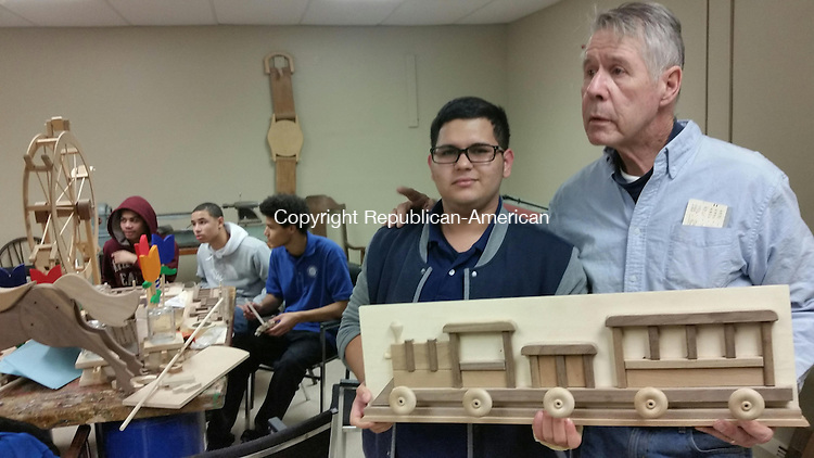 WATERBURY - Waterbury Youth Services wood-working teacher Billy Dwyer with Alex Rivera, 17, of Waterbury, in the wood shop Monday afternoon.