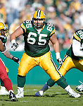 Offensive lineman Mark Tauscher #65 of the Green Bay Packers prepares to block during an NFL football game against the Arizona Cardinals at Lambeau Field on October 29, 2006 in Green Bay, Wisconsin. The Packers beat the Cardinals 31-14. (Photo by David Stluka)