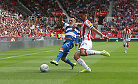 Queens Park Rangers' Josh Scowen is tackled by Stoke City's Danny Batth <br /> <br /> Photographer Stephen White/CameraSport<br /> <br /> The EFL Sky Bet Championship - Stoke City v Queens Park Rangers - Saturday 3rd August 2019 - bet365 Stadium - Stoke-on-Trent<br /> <br /> World Copyright © 2019 CameraSport. All rights reserved. 43 Linden Ave. Countesthorpe. Leicester. England. LE8 5PG - Tel: +44 (0) 116 277 4147 - admin@camerasport.com - www.camerasport.com