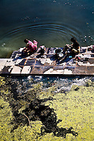 Women washing clothes on the banks of lake Pichola. (Photo by Matt Considine - Images of Asia Collection)