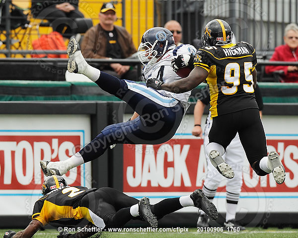 September 6, 2010; Hamilton, ON, CAN; Hamilton Tiger-Cats defensive back Jason Shivers (2) knocks the feet out from under Toronto Argonauts offensive tackle Chris Van Zeyl (54). CFL football: Labour Day Classic - Toronto Argonauts vs. Hamilton Tiger-Cats at Ivor Wynne Stadium. The Tiger-Cats defeated the Argonauts 28-13. Mandatory Credit: Ron Scheffler.