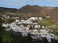 Busquistar, Taha Valley, Alpujarra, Andalucia, Southern Spain, against a mountainous background. Moorish influence is seen in the distinctive cubic architecture of the Sierra Nevada's Alpujarra region, reminiscent of Berber architecture in Morocco's Atlas Mountains. Photograph by Manuel Cohen.