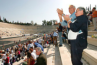 02 NOV 2003 - ATHENS, GRE - Spectators watch the finish f the 21st Athens Athens Classic Marathon in the Kallimarmaro Stadium (PHOTO (C) NIGEL FARROW)