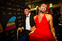 "GOLD COAST, Queensland/Australia (Friday, February 24, 2012) Matt Wilkinson (AUS) with his 'date' Nick Pollet (AUS). – The 29th Annual ASP World Surfing Awards went off tonight at the Gold Coast Convention and Exhibition Centre with the world's best surfers trading the beachwear for formal attire as the 2011 ASP World Champions were officially crowned.. .Kelly Slater (USA), 40, and Carissa Moore (HAW), 19, took top honours for the evening, collecting the ASP World Title and ASP Women's World Title respectively.. .""I have actually been on tour longer than some of my fellow competitors have been alive,"" Slater said. ""All joking aside, it's truly humbling to be up here and honoured in front of such an incredible collection of surfers. I want to thank everyone in the room for pushing me to where I am.""..In addition to honouring the 2011 ASP World Champions, the ASP World Surfing Awards included new accolades voted on by the fans and the surfers themselves...For the first time in several years, ASP Life Membership was awarded to Hawaiian legend and icon of high-performance surfing, Larry Bertlemann (HAW), 56...""Where surfing is today is where I dreamed it should be in the 70's,"" Bertlemann said. ""You guys absolutely deserve this and I'm so honored to be up here in front of you all tonight."".Grammy Award-winning artists Wolfmother and The Vernons rounded out the night's entertainment which was all streamed LIVE around the world on YouTube.com..Photo: joliphotos.com"